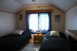 A bedroom in the upper floor